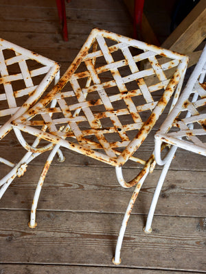 Four vintage French iron garden stools