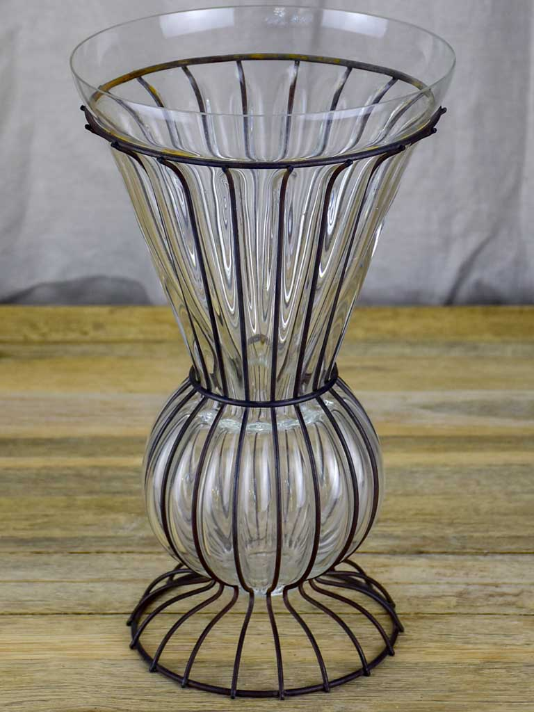 Tall blown glass vase in metal frame