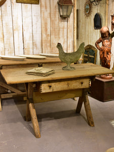 Late 19th century French farm table with cross braced legs