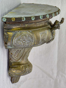 Antique French floating metal console with cherub