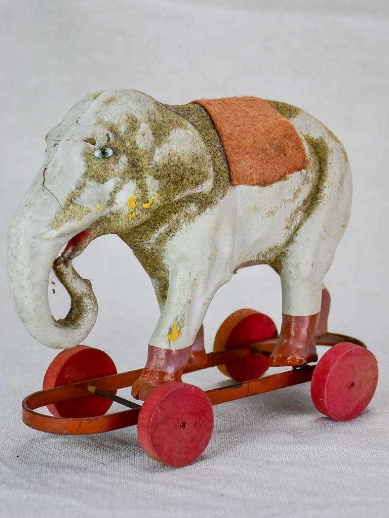 Antique French toy elephant on wheels - small