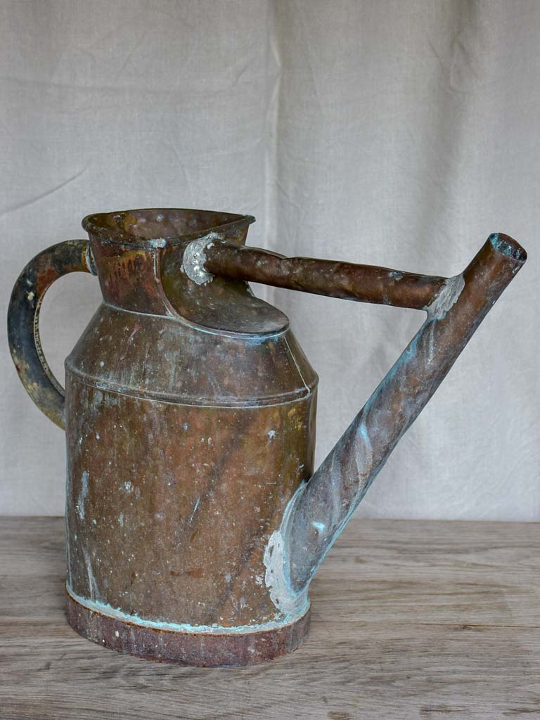 Antique French copper watering can with brace
