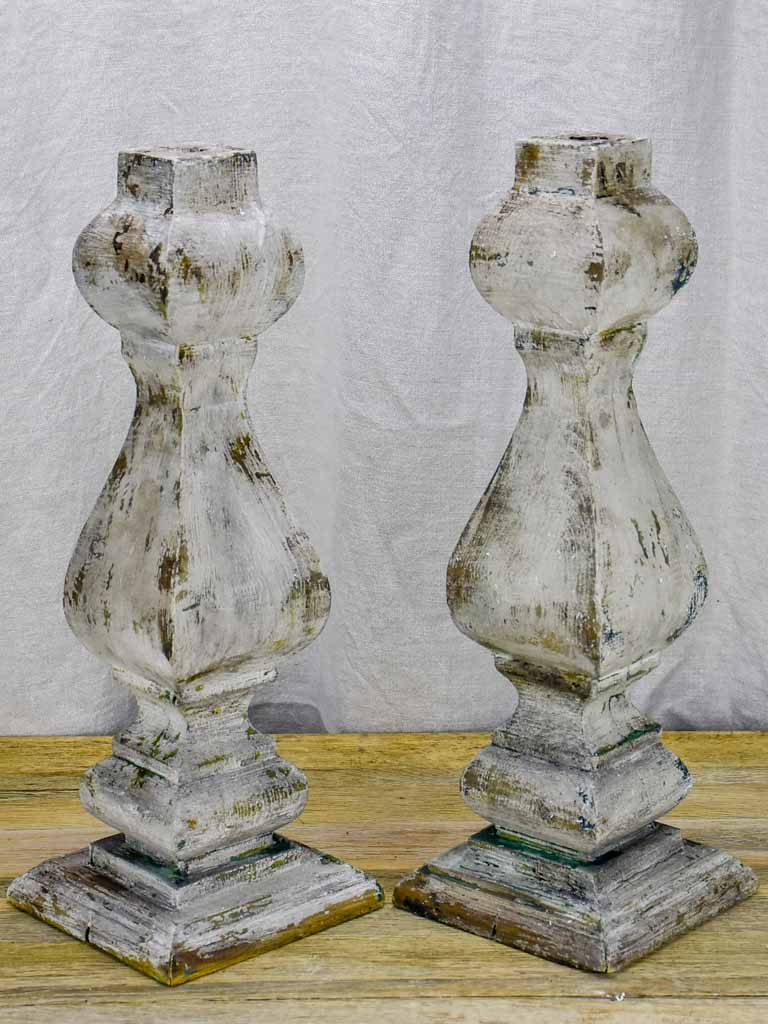 Pair of salvaged wooden decorative elements / candlesticks with grey patina