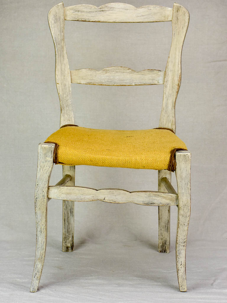 Antique French children's chair with jute seat and beige / grey frame