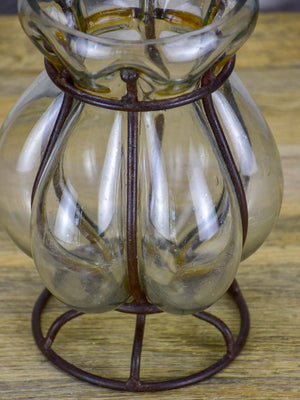 Blown glass vase in metal frame