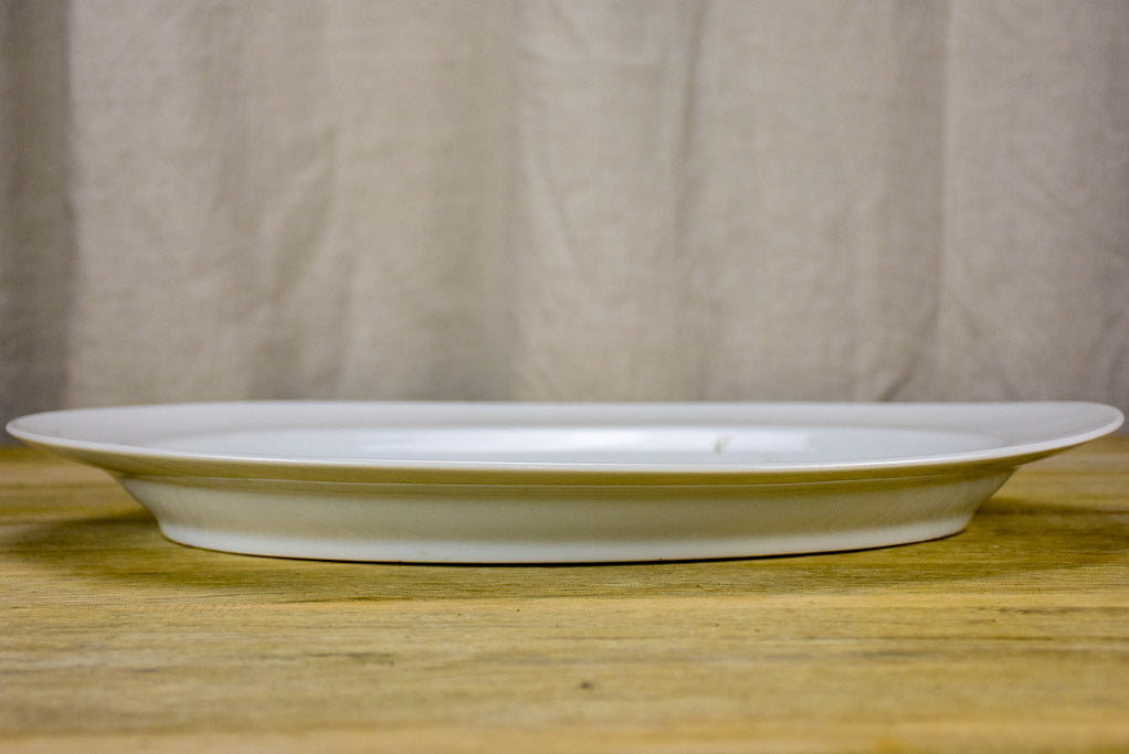 Pair of antique French oval platters with basin for jus