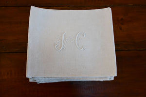 Set of 11 vintage French linen serviettes with JC monogram