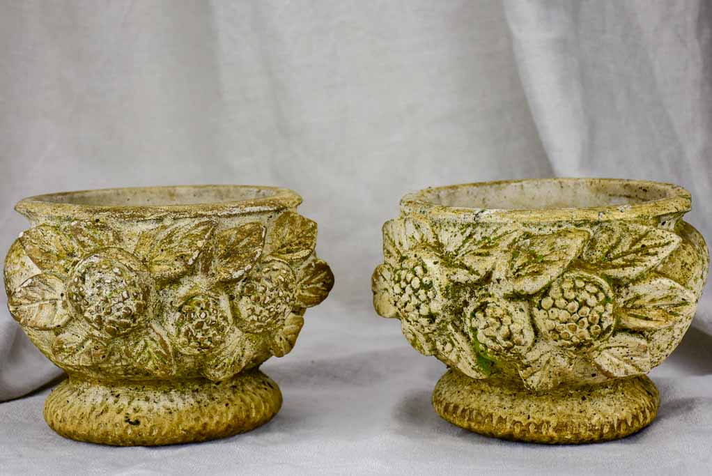 Pair of concrete flower pots decorated with pomegranates