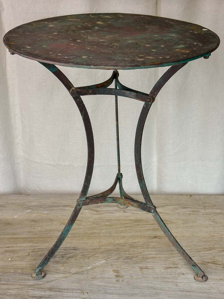 Round antique French garden table with green patina