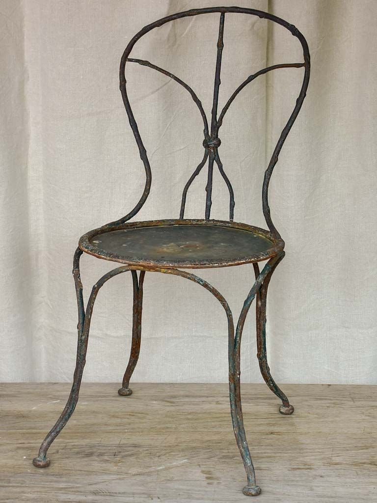 Antique French garden chair with branch - like back