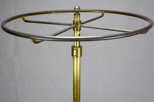 Antique French clothes rack display from a boutique - brass