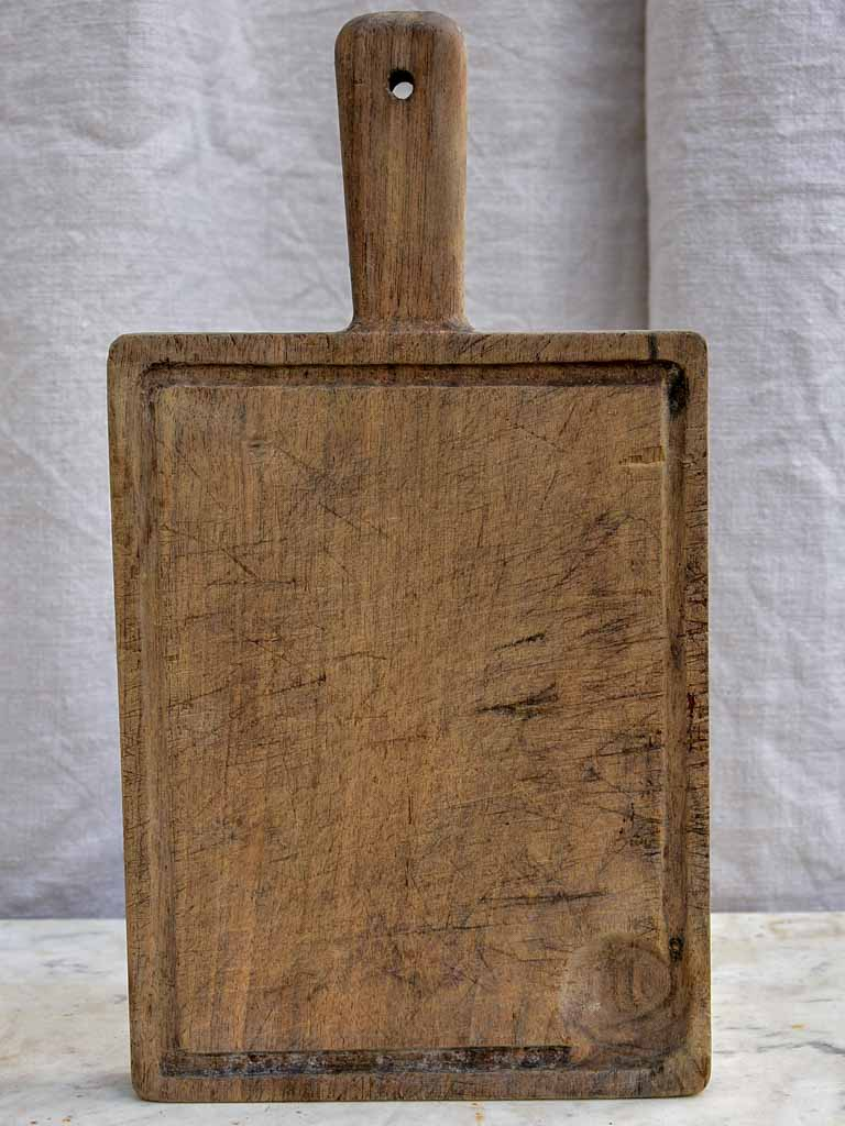 Small antique French cutting board with catchment gutter