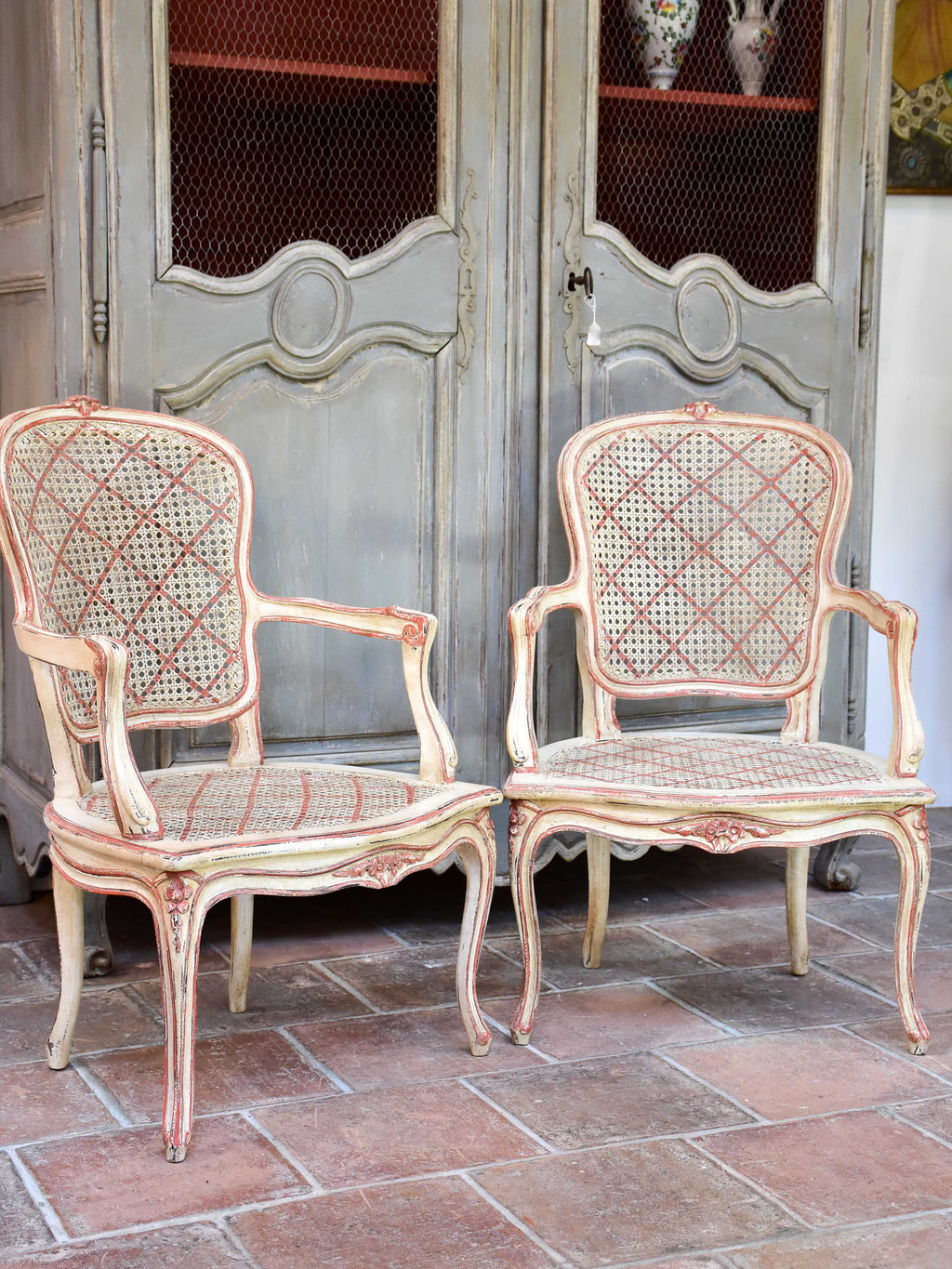 Pair of antique rattan Louis XV armchairs