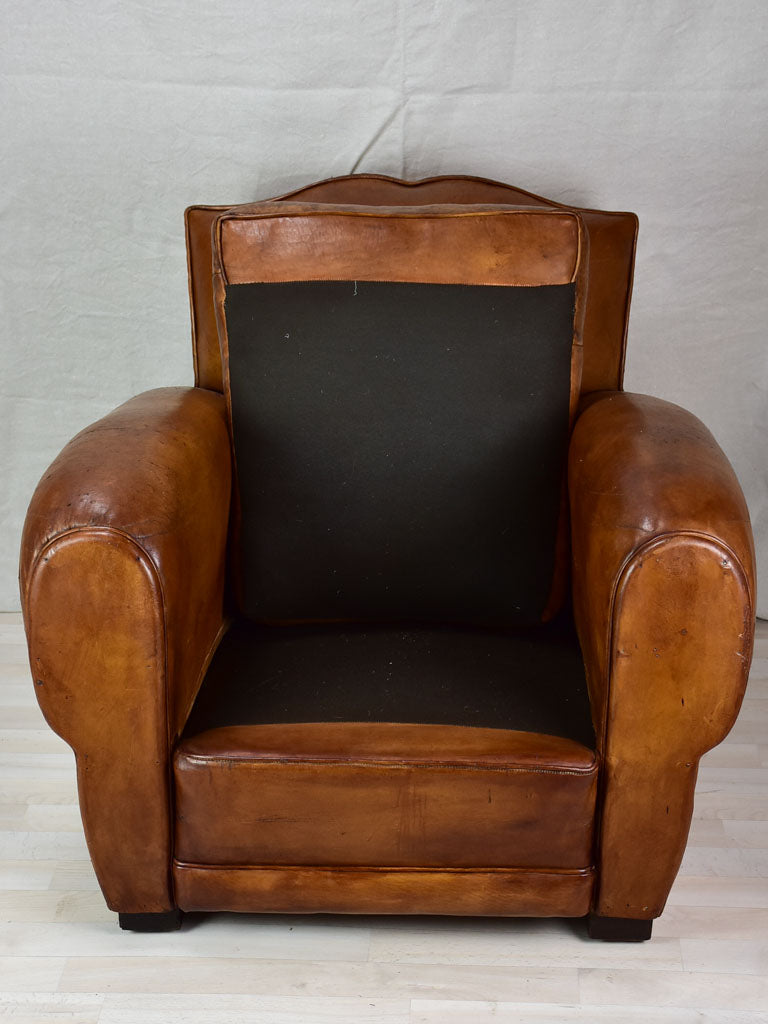 Large 1950's French leather club chair with mustache back and barrel arms