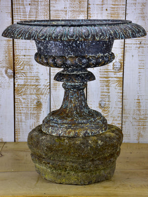 Large antique French medici urn mounted on a stone pedestal