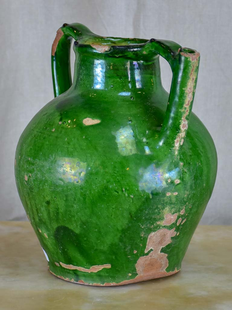 Antique French water jug with green glaze