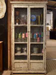 Rustic French armoire with grillwork doors
