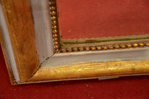 Painted Louis Philippe mirror with grey and gold frame