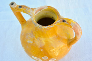Antique French water pitcher with orange / yellow glaze