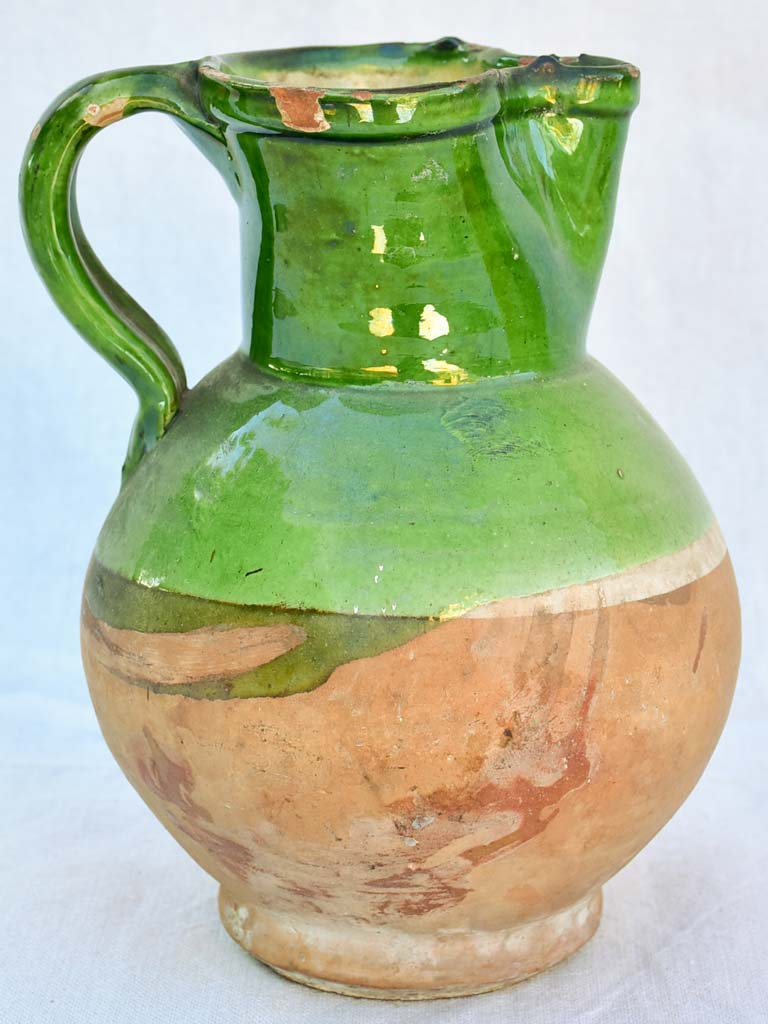 Antique French water pitcher with green glaze and pinched beak 10¼""