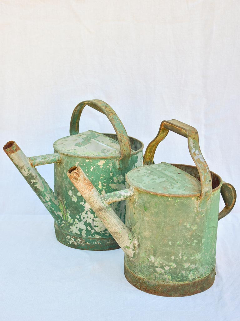 RESERVED MA Two antique French watering cans with green patina