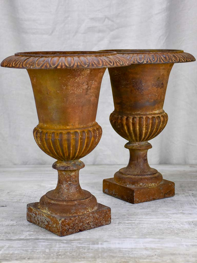 "Pair of 19th Century cast iron Medici urns 13½"" (UNAVAILABLE)"