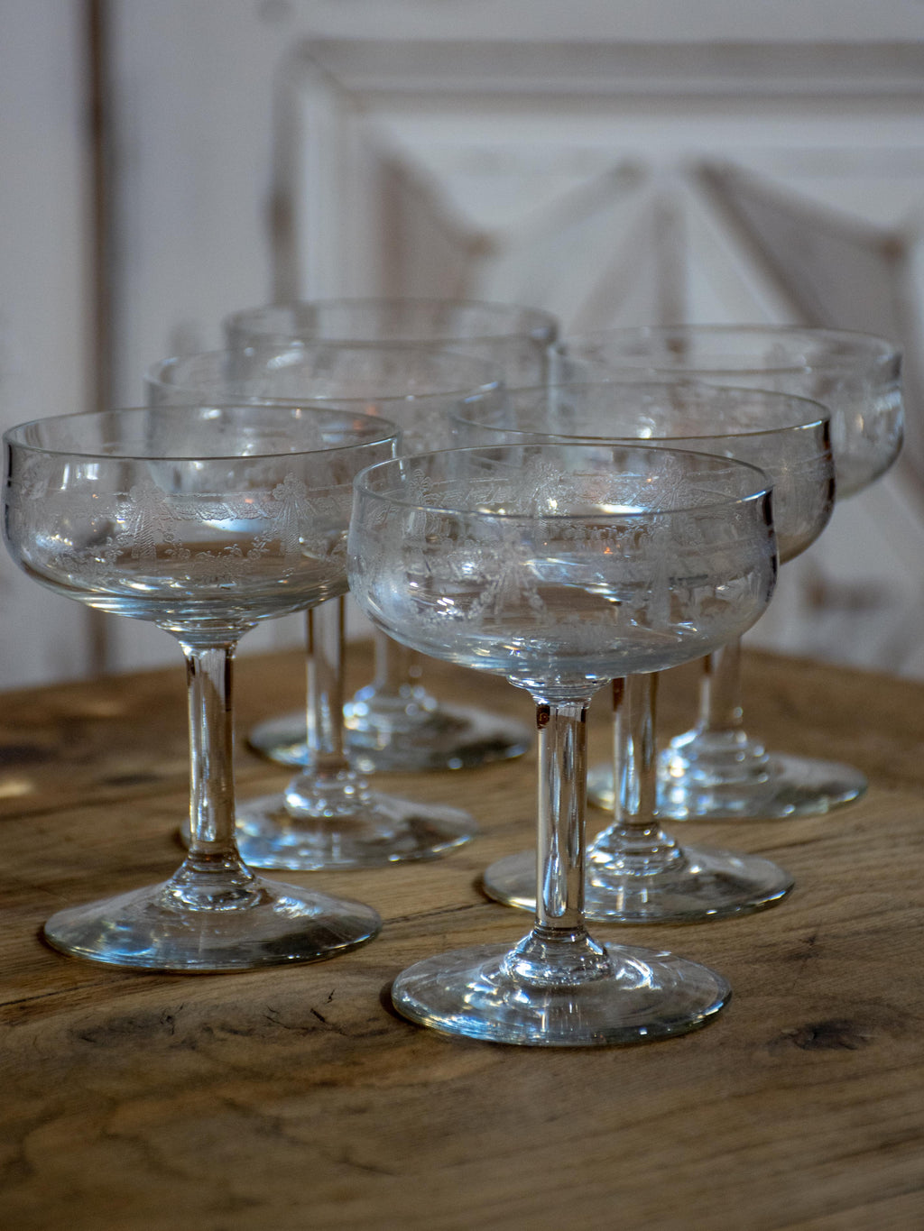 Six antique French champagne cups engraved with bows and garlands