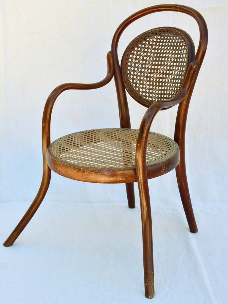 Antique French children's bentwood and cane armchair