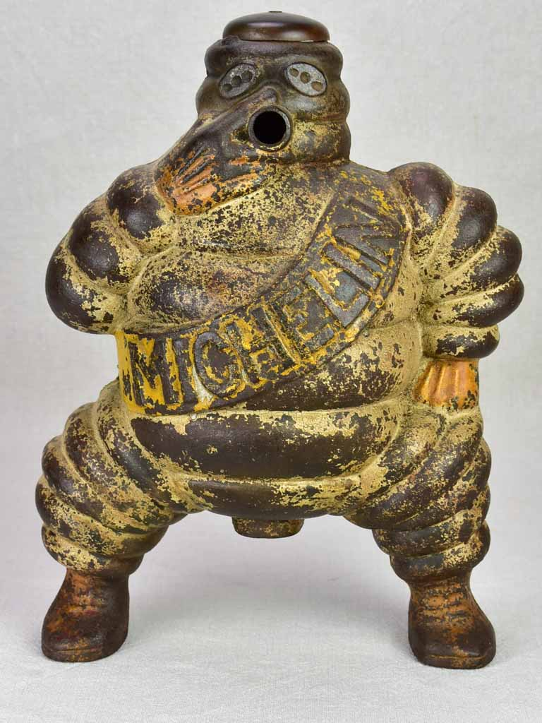 Early 20th century Michelin man, Bibendum from a large air compressor