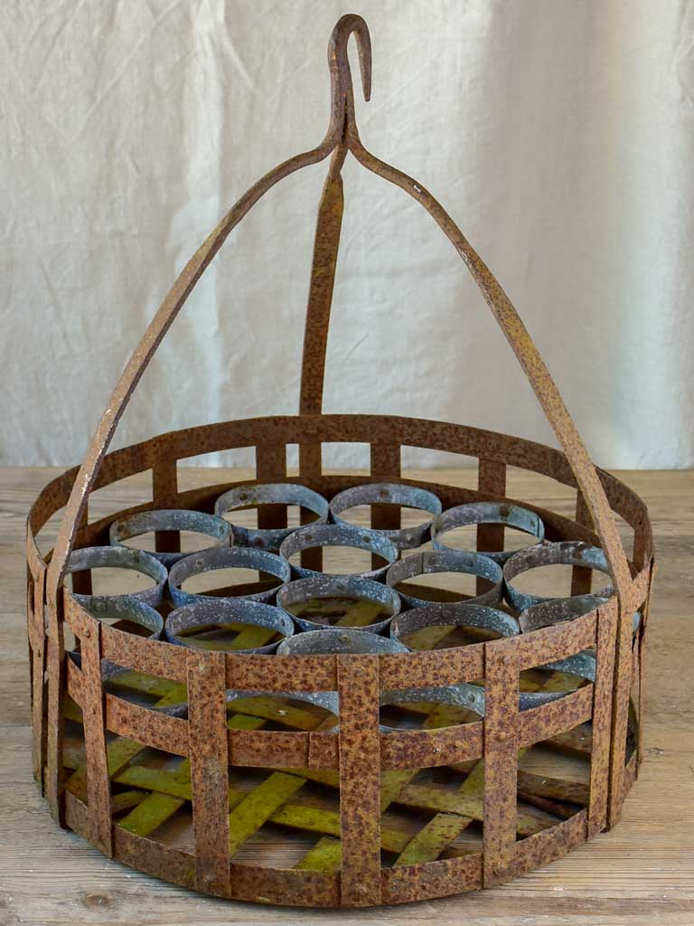 Large antique French bottle holder for a well