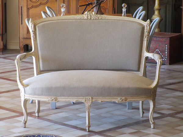 Upholstered two person Louis XVI canape