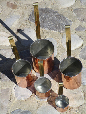 Set of five chef's copper measuring cups tin lined