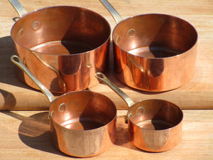 Set of four chefs miniature copper saucepans