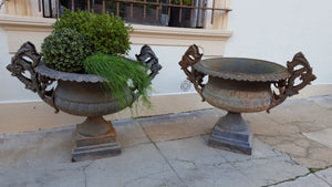 Pair of extra large antique French cast iron Medici urns with overarching handles