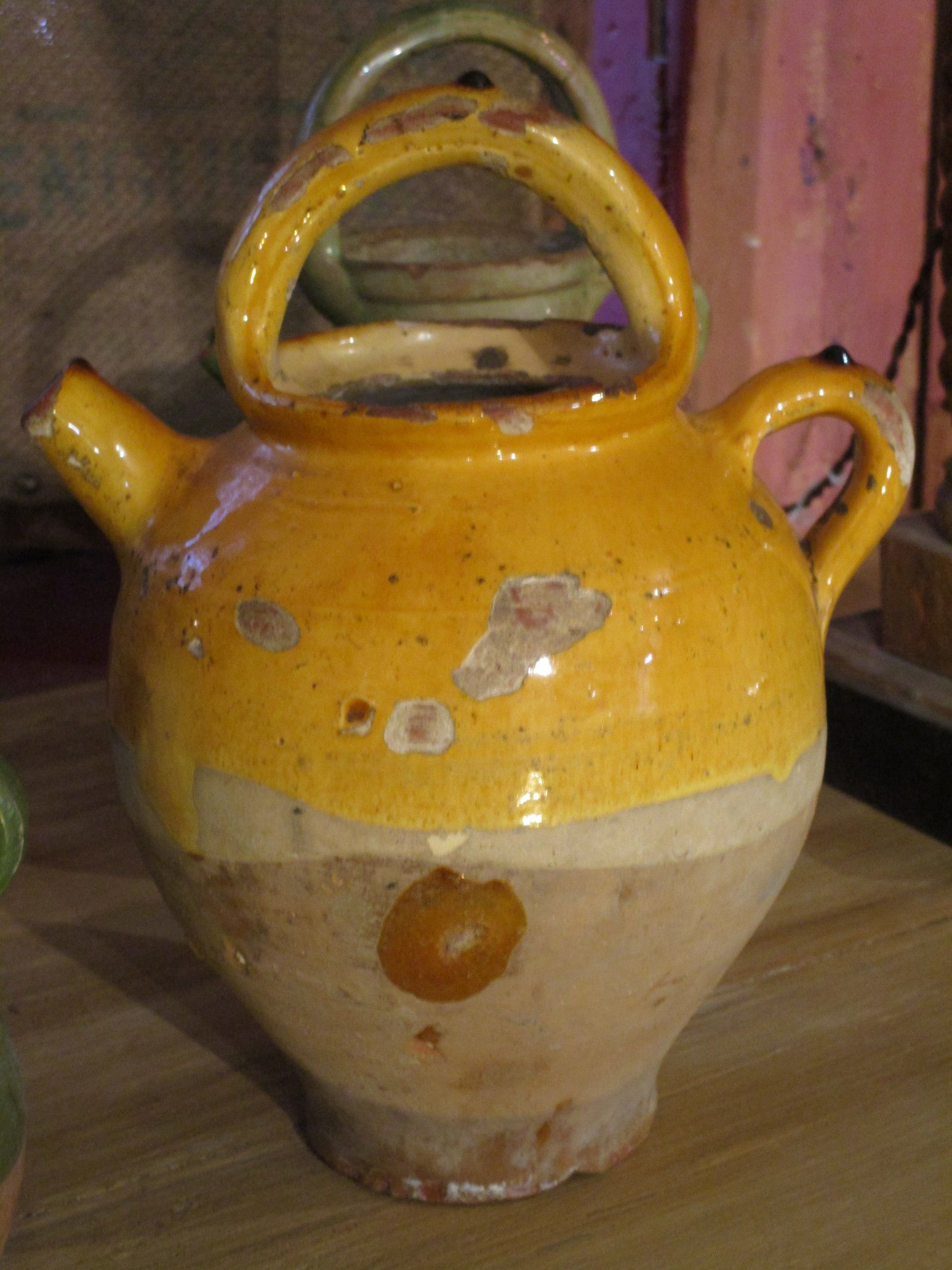 Provencal water jug with orange glaze 10½""