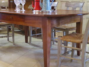 rustic oval dining table in walnut six person