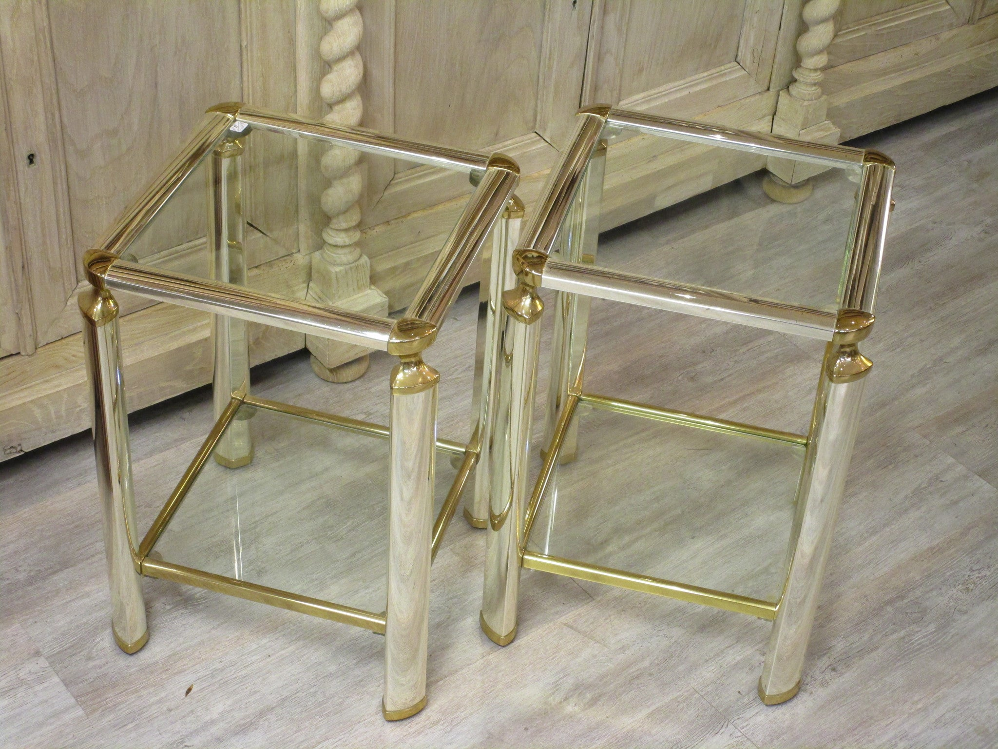 Pair of silver and gold French side tables glass shelves