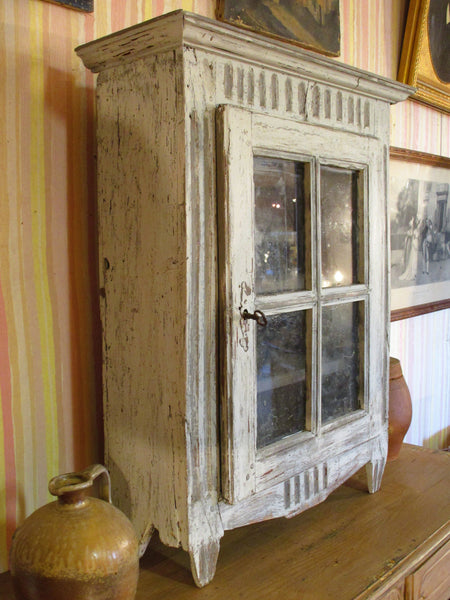Side view of Rustic French provincial cabinet showcase with french door