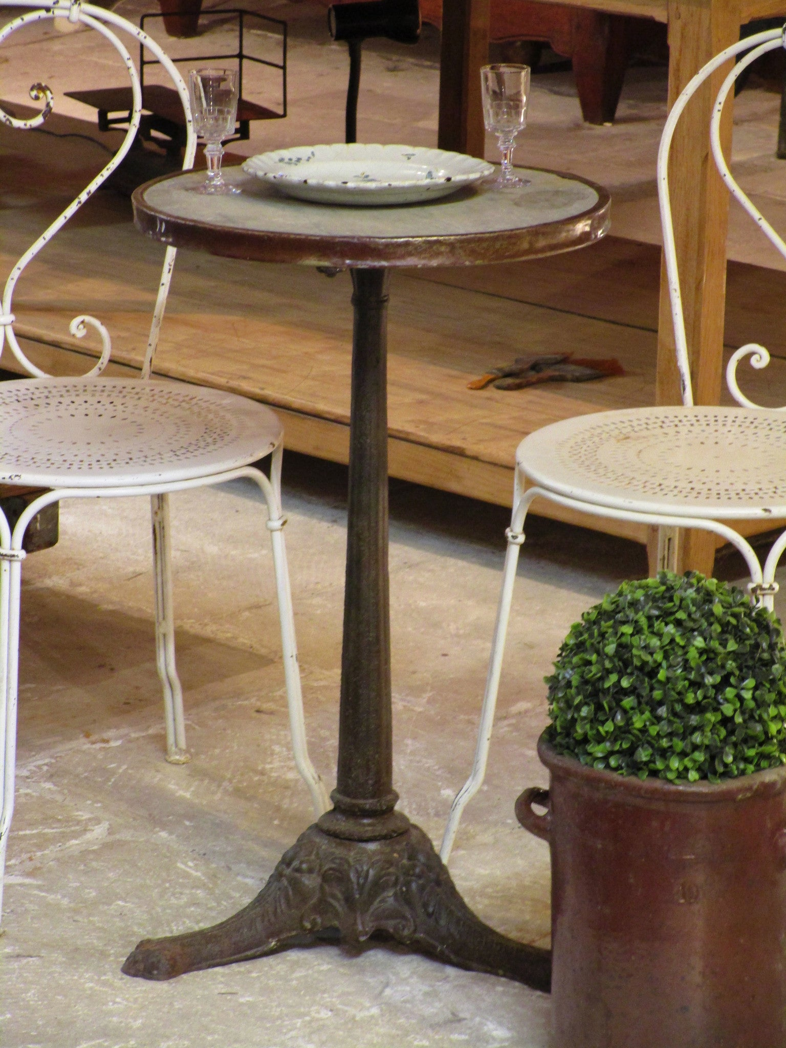 Round Parisian cafe marble top table