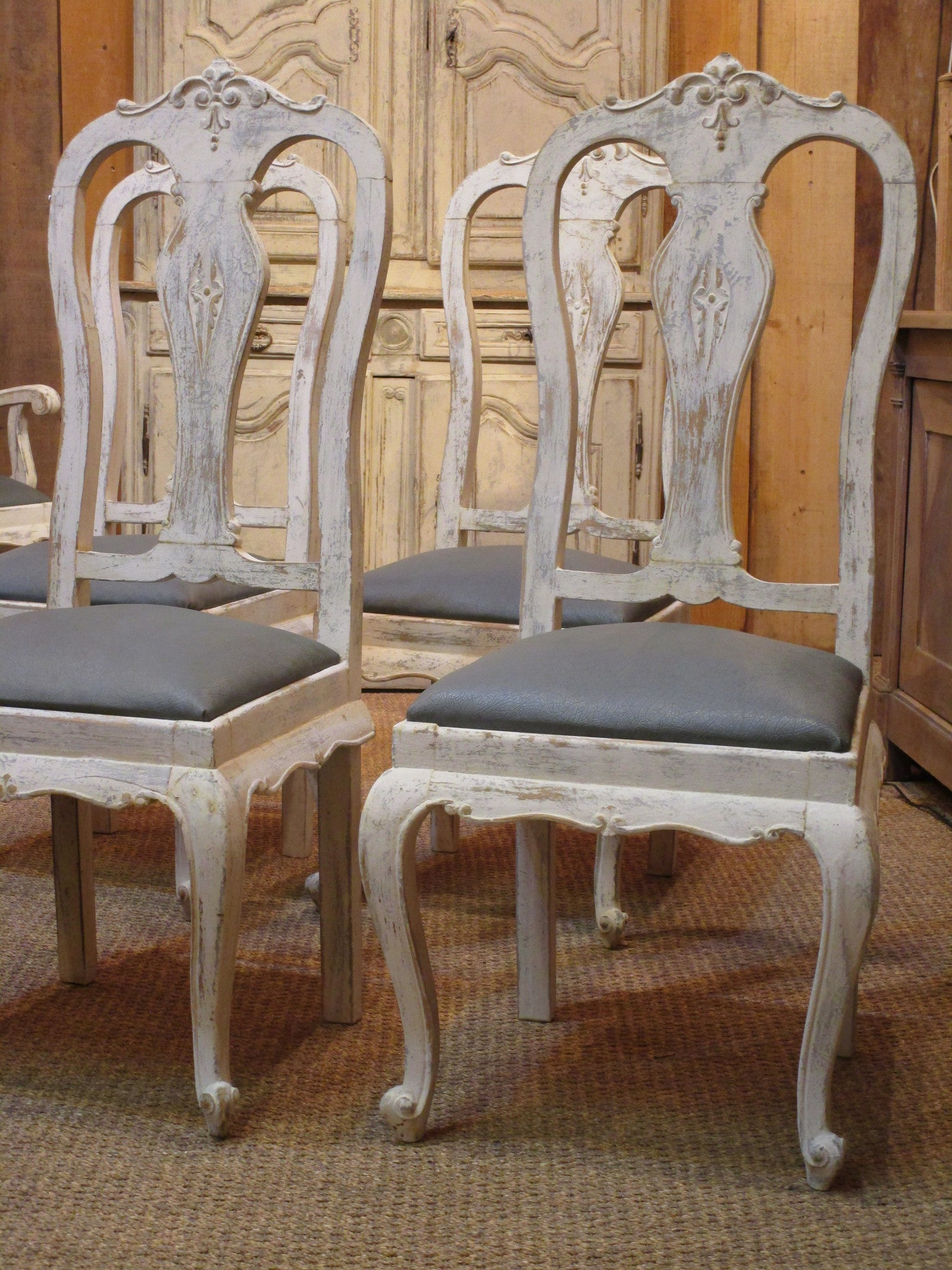 Set of four oak Chippendale dining chairs