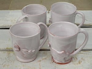 Set of four glazed ceramic cups