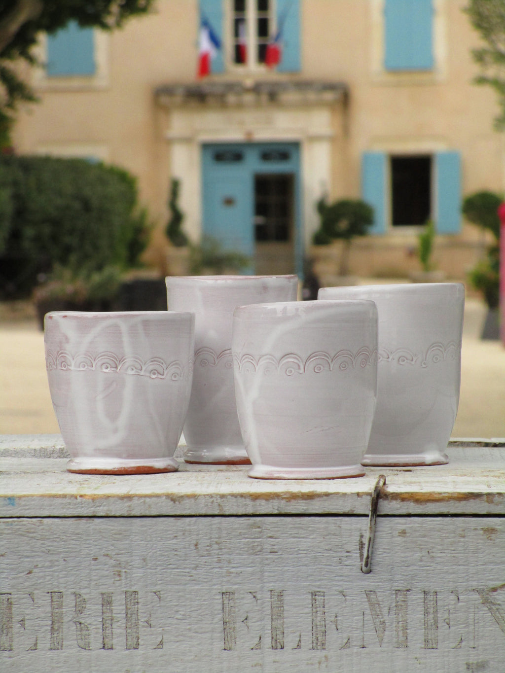 set of four artisan glazed white coffee cups