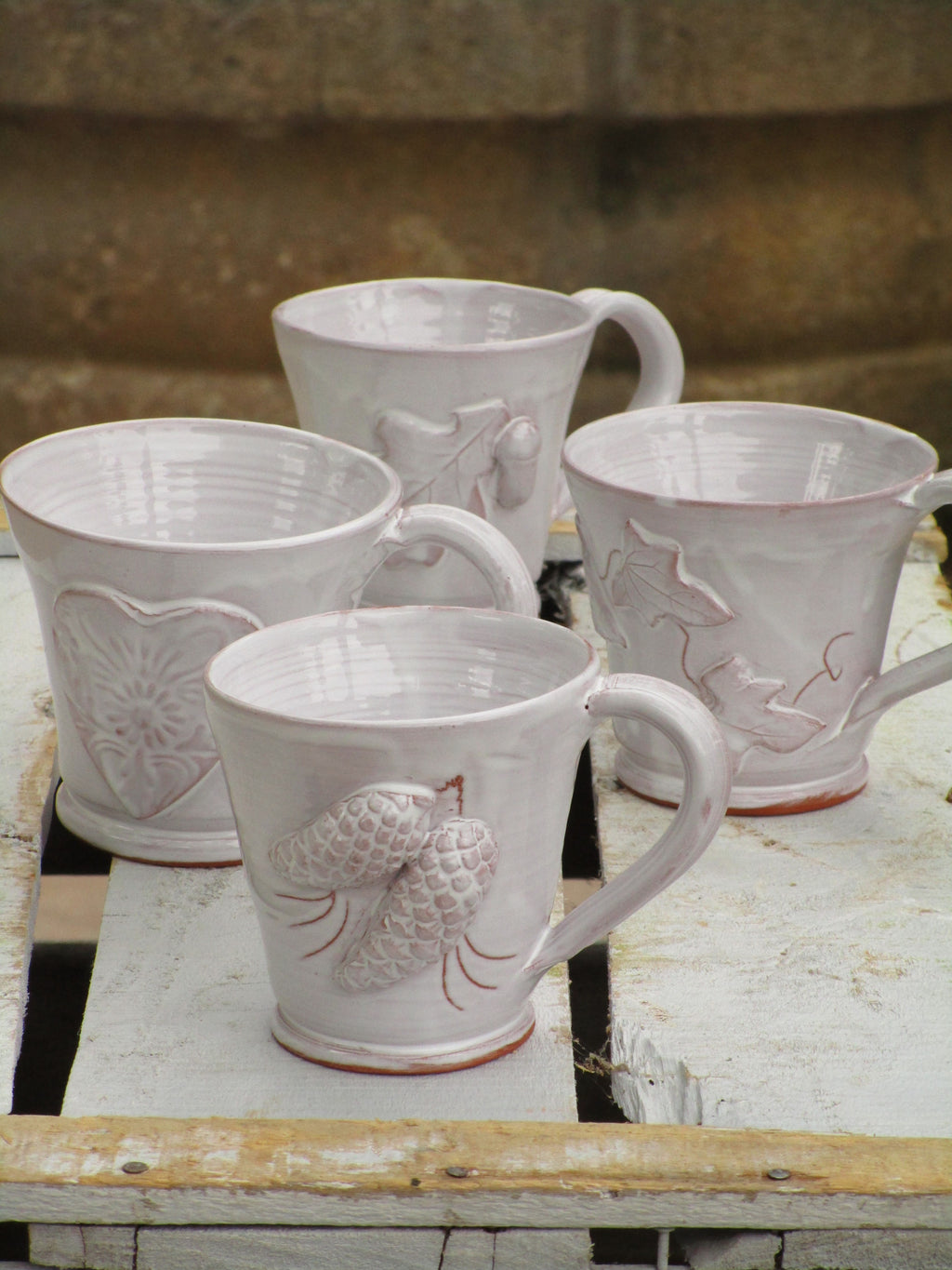 four glazed tea cups handmade in france