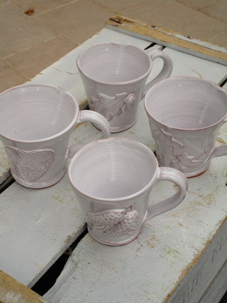top four glazed mugs bespoke french heart pinecone acorn vine