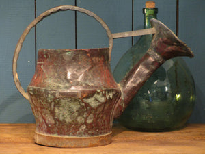 side view ancient rustic french watering can