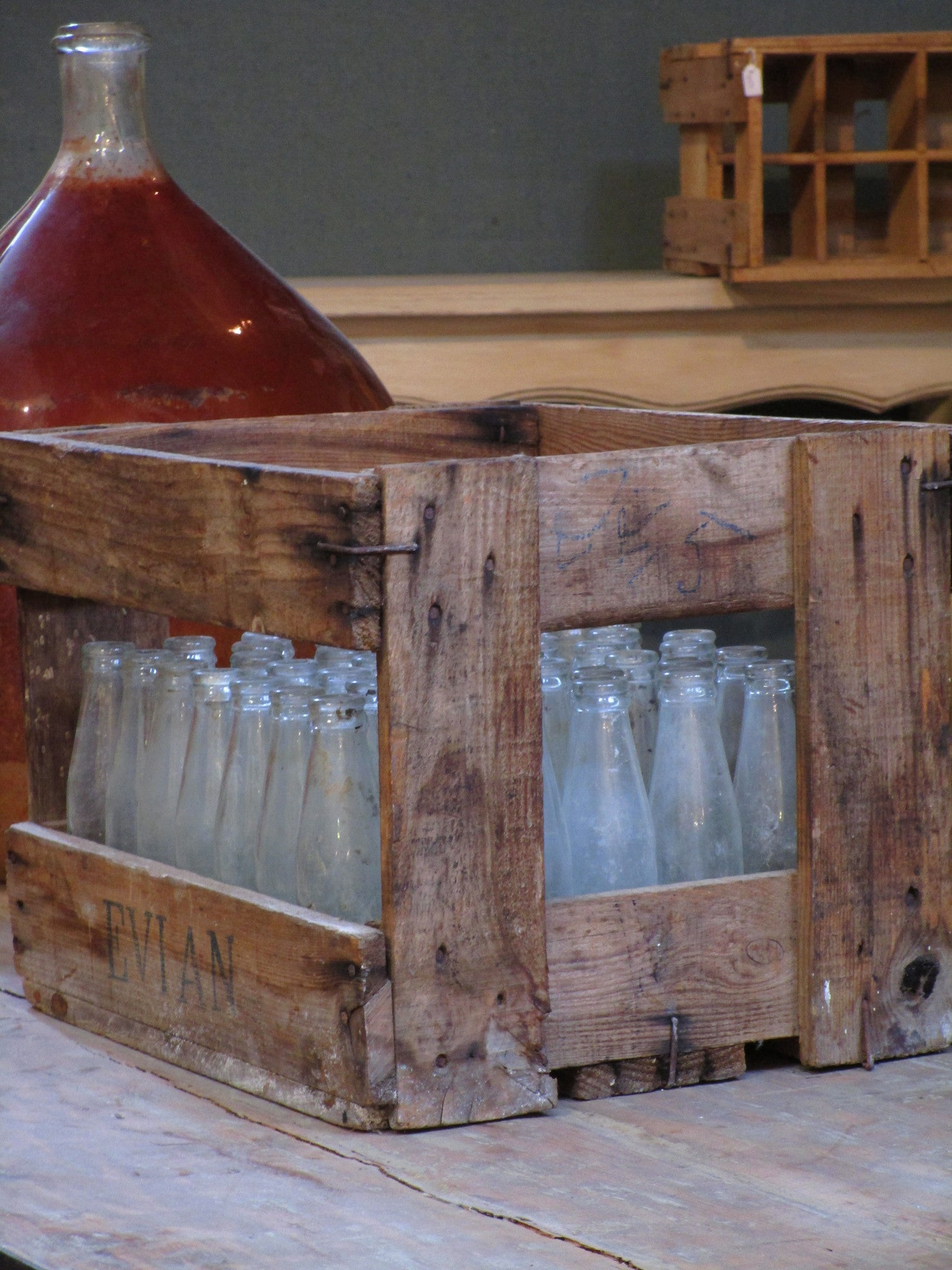 Vintage juice bottles in a rustic wooden box