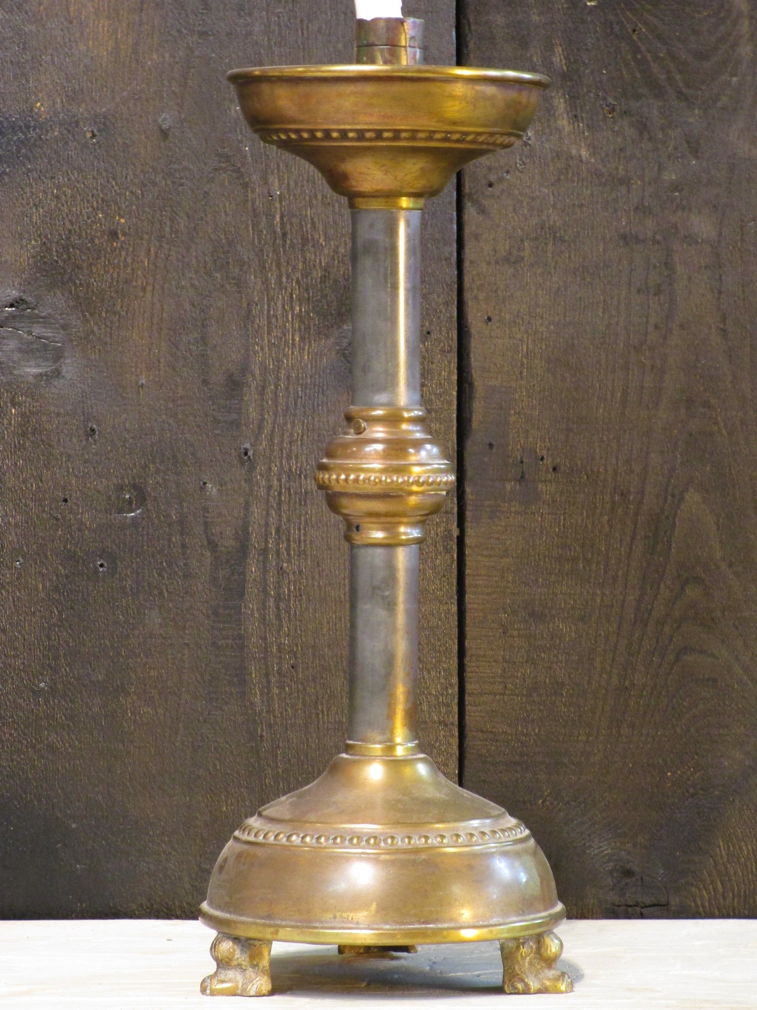 Antique French candlestick with bronze feet