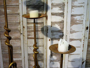 Set of three wrought iron candlesticks