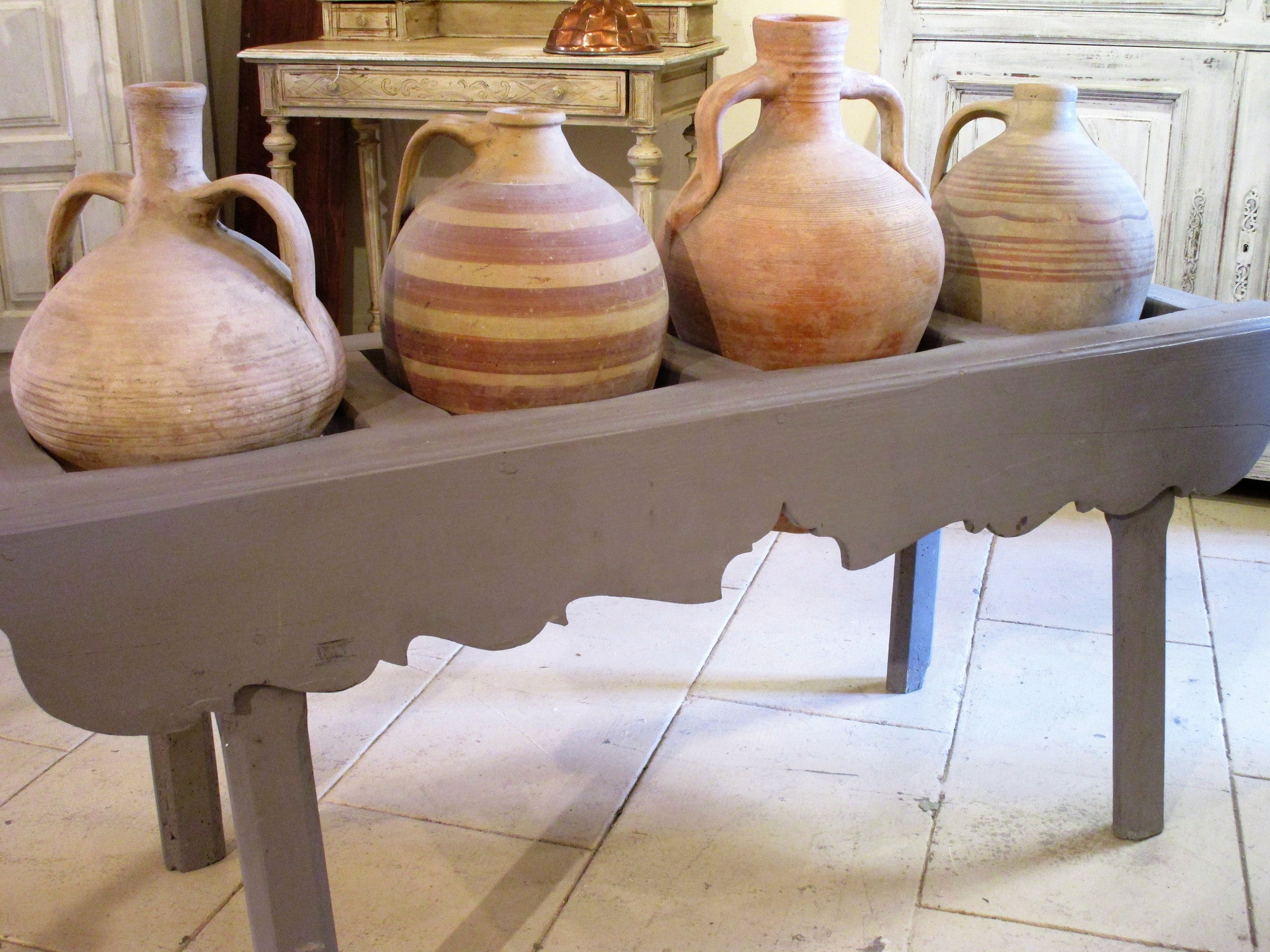 French table with four olive oil jars