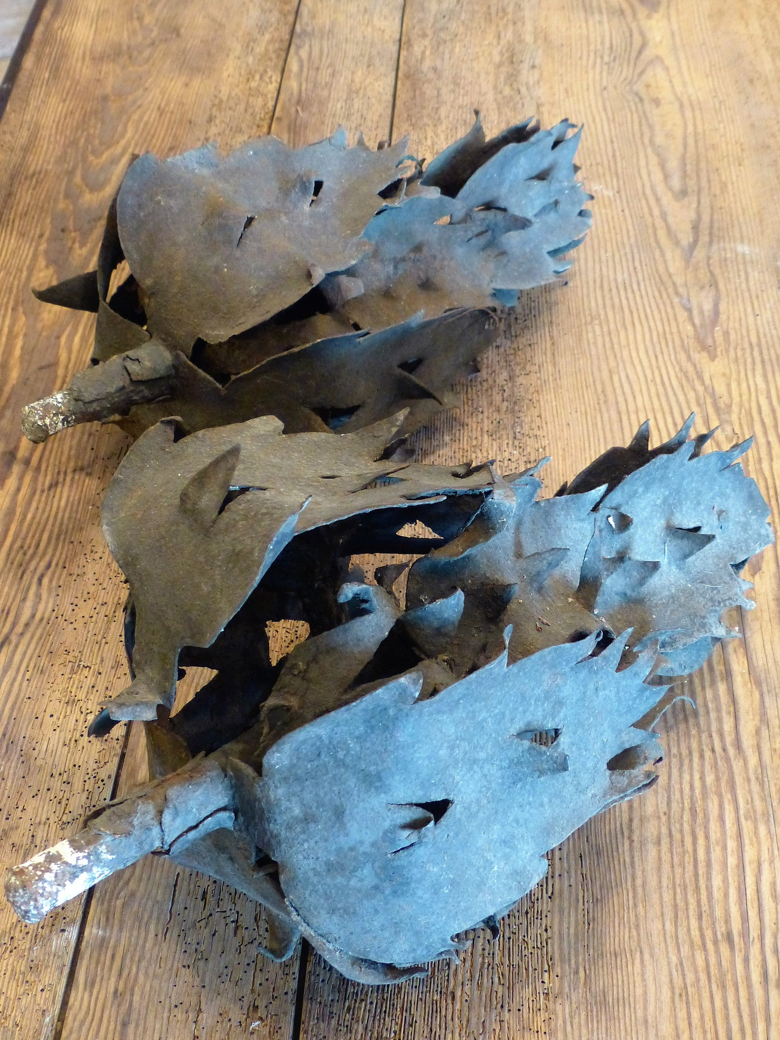 Rare pair of 18th century flame sculptures in iron